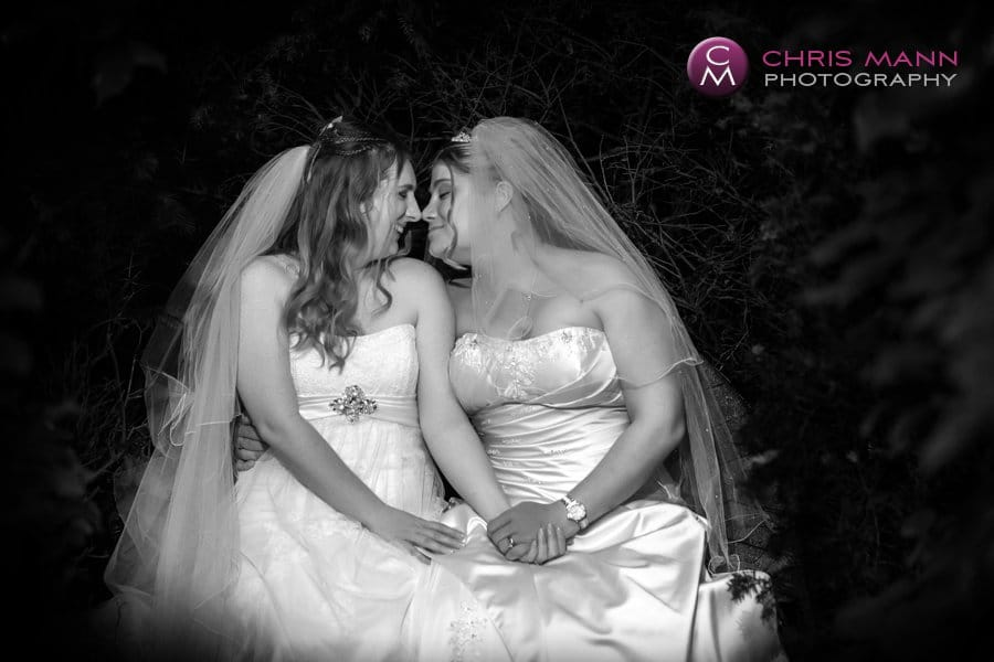 two brides share a moment civil partnership langshott manor gardens