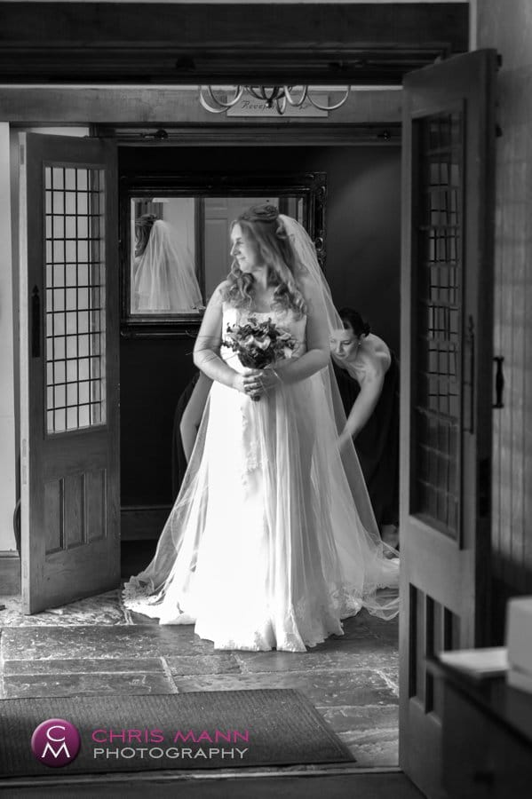 bride sidelit in doorway