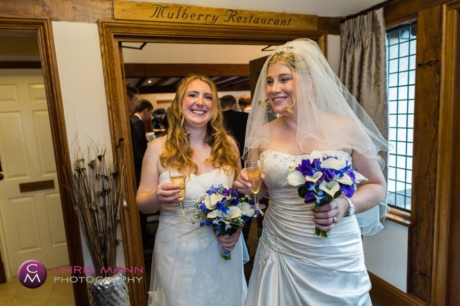 happy brides with champagne civil wedding surrey