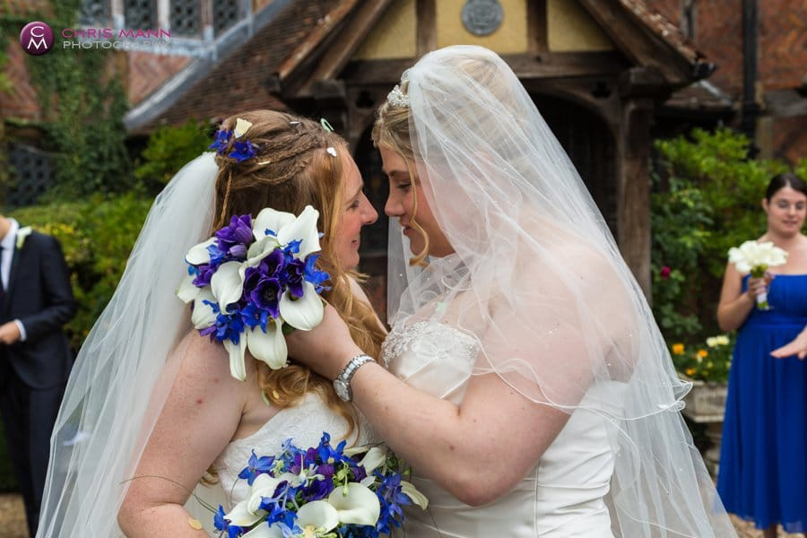 couple embrace outside langshott manor wedding