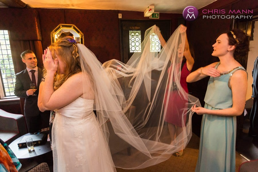 wedding guests admire bride's veil