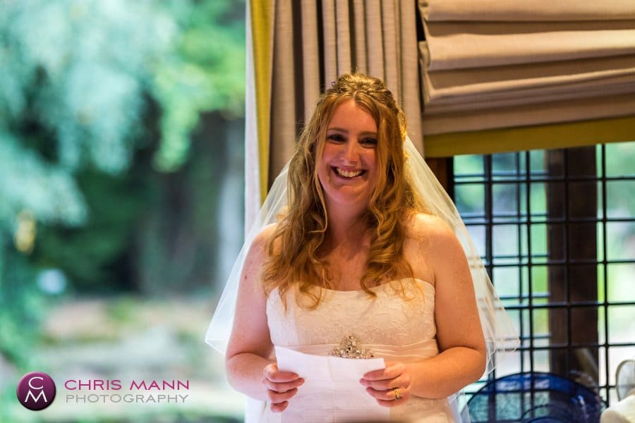 bride gives speech at wedding reception