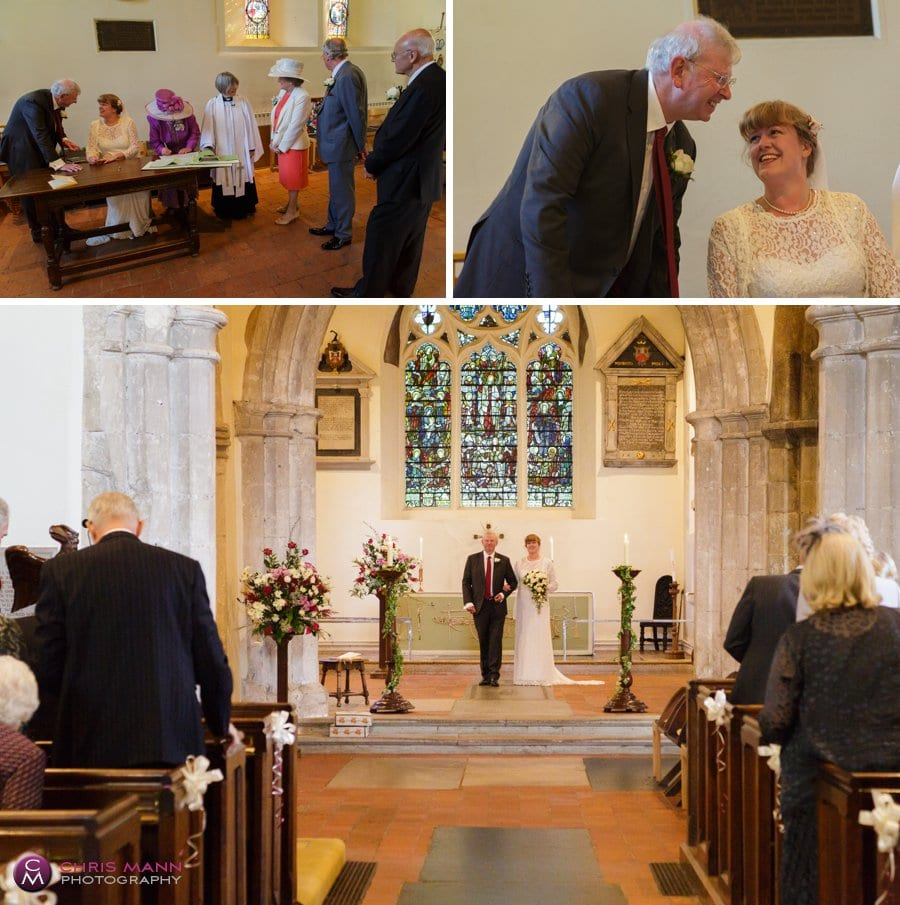 signing the register wedding ceremony st james church shere