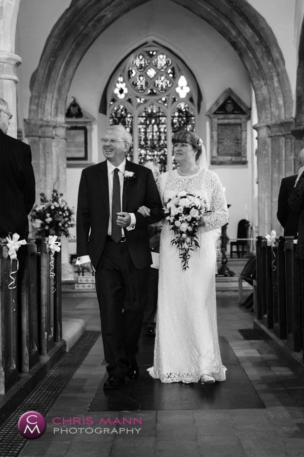 bride and groom walk down the aisle recessional church wedding
