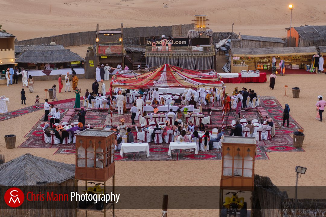 guests assemble for an African wedding in the Dubai desert