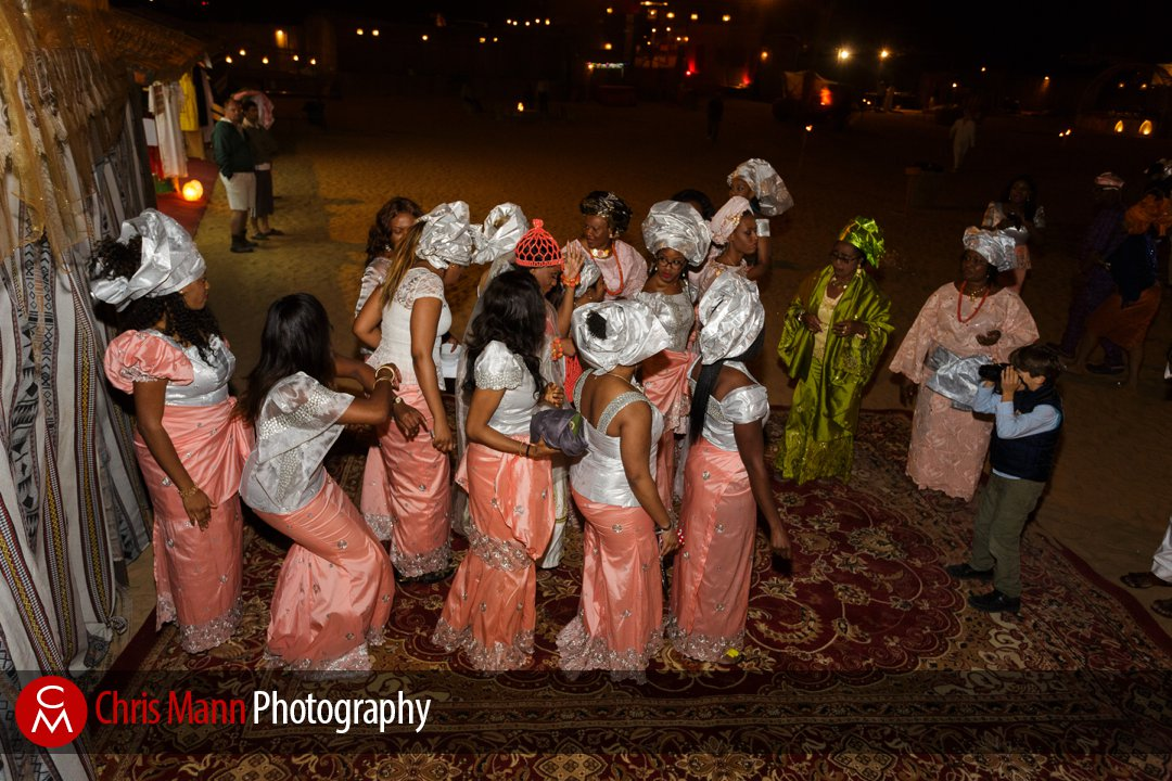 bridesmaids escort the bride to her African wedding in the Dubai desert
