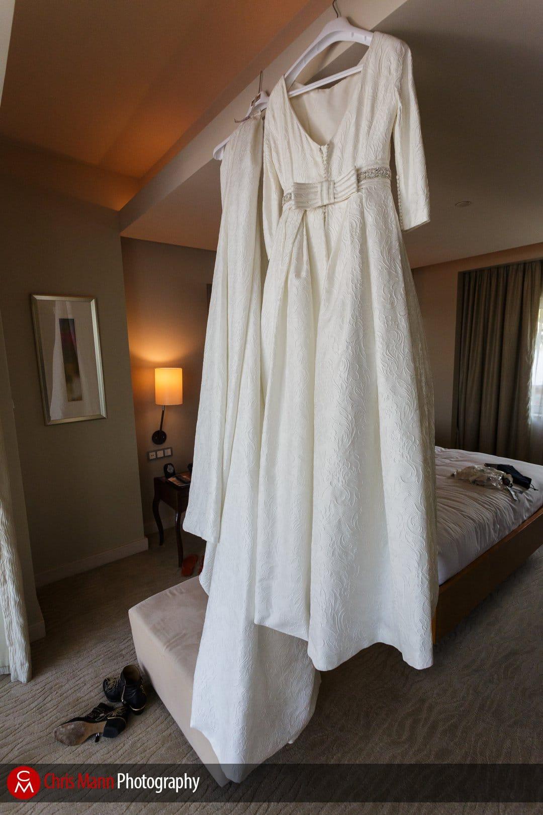 wedding dress hanging in room at Park Hyatt Dubai