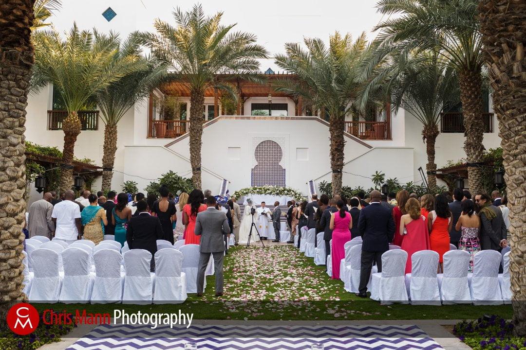 guests watch a couple recite wedding vows Fountain Garden Park Hyatt Dubai