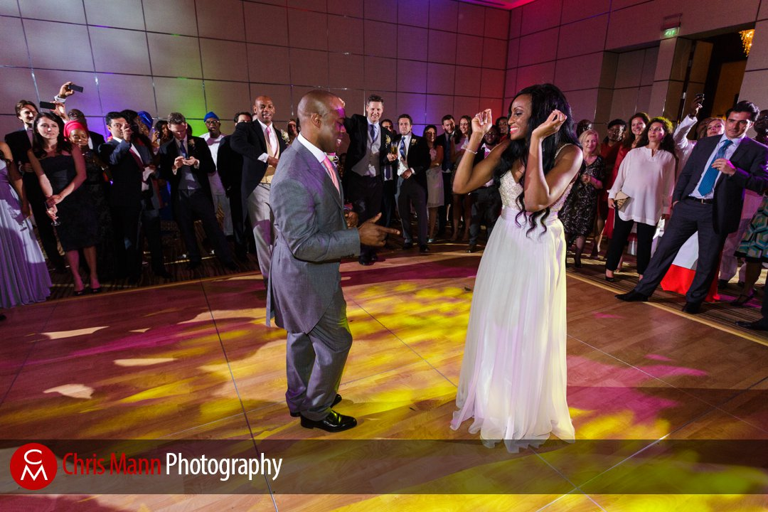 guests look on as bride and groom dance in the Grand Ballroom Park Hyatt Dubai