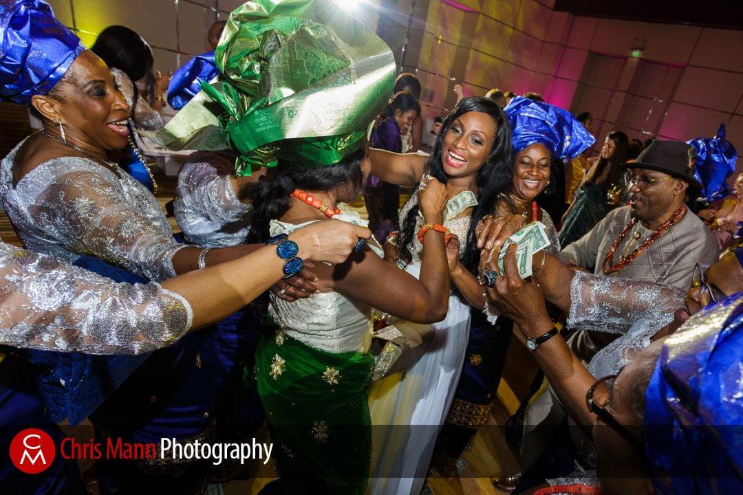 happy guests and family surround the bride on the dancefloor Park Hyatt Dubai