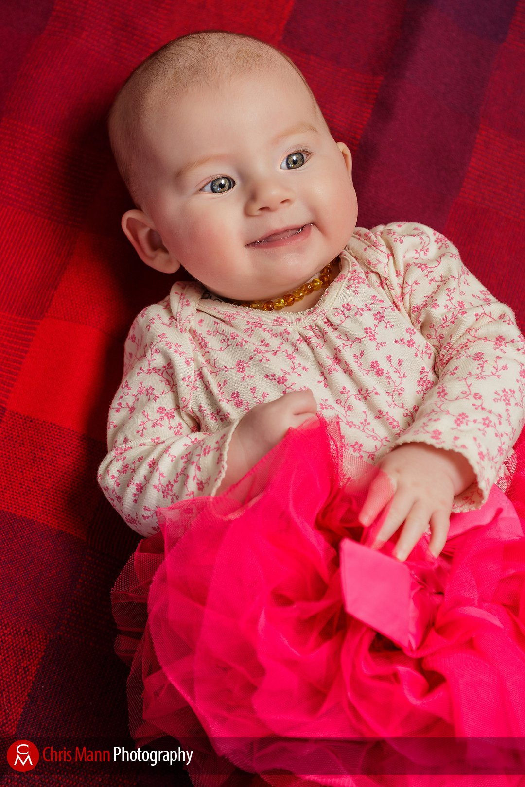 happy baby on red rug background