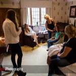 bride getting ready in a bedroom at Langshott Manor