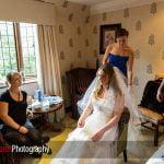 bridal preparations in a bedroom at Langshott Manor