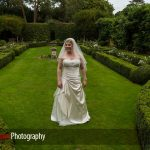 bride in gardens at Langshott Manor