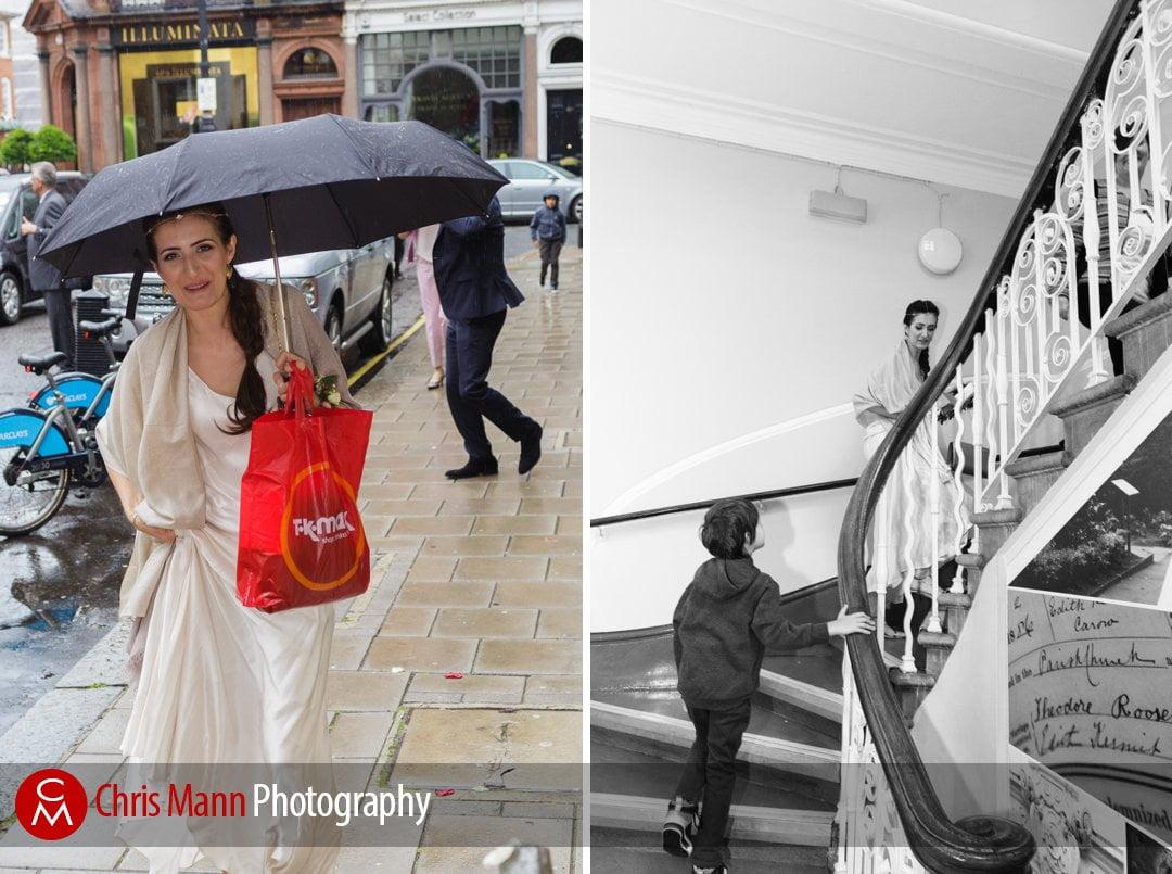 bride arrives with umbrella held high for her wedding