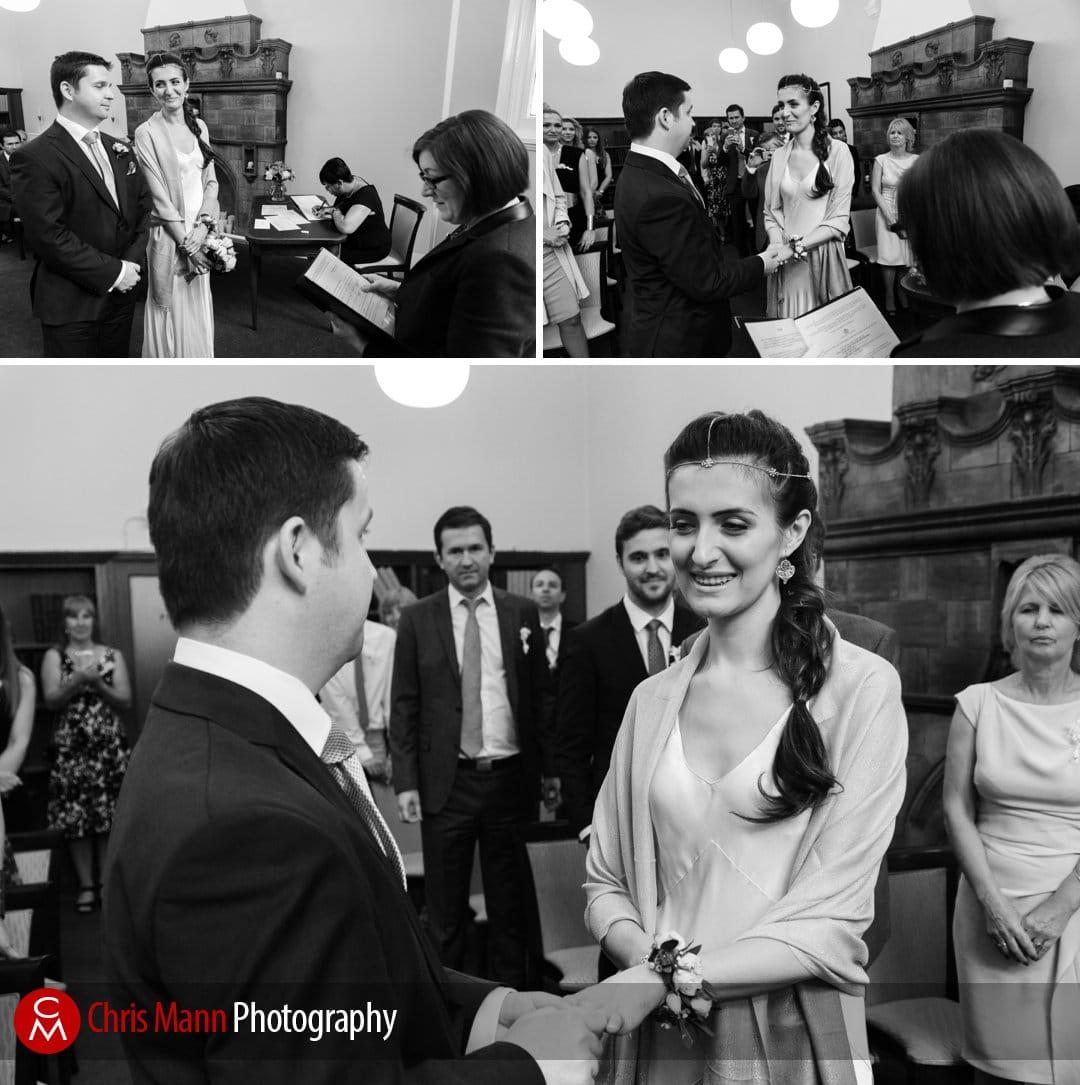 bride and groom exchange rings Mayfair Library wedding