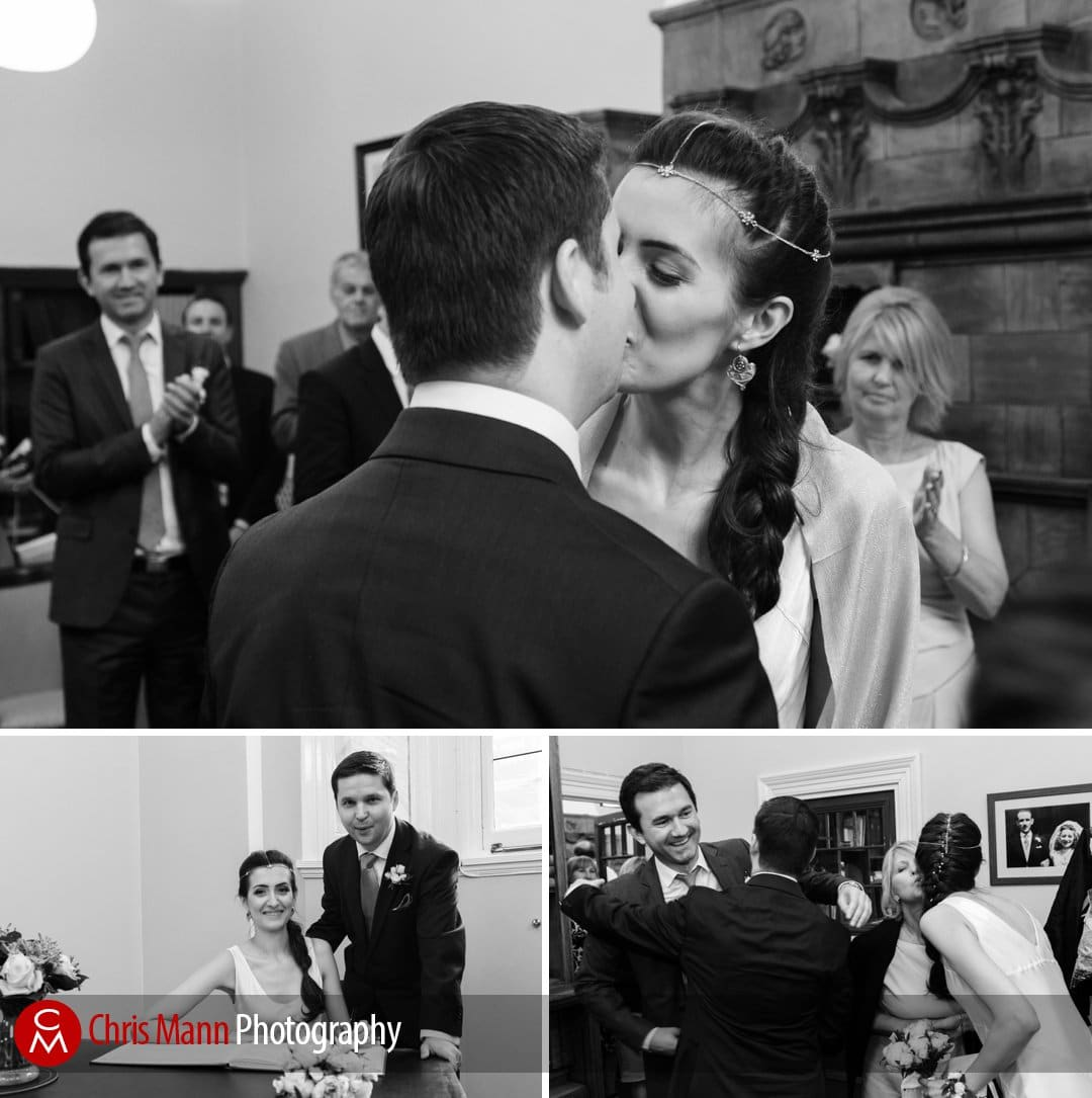 first kiss and signing the register - Mayfair Library wedding