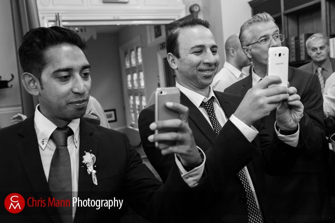 guests photograph the happy couple with their cellphones