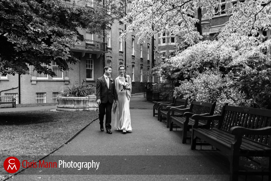 bride and groom walking together in Mount Street Gardens London W1