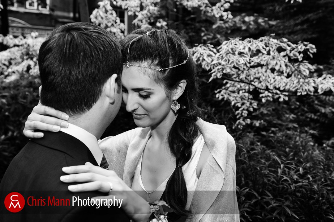 bride and groom embrace in Mount Street Gardens