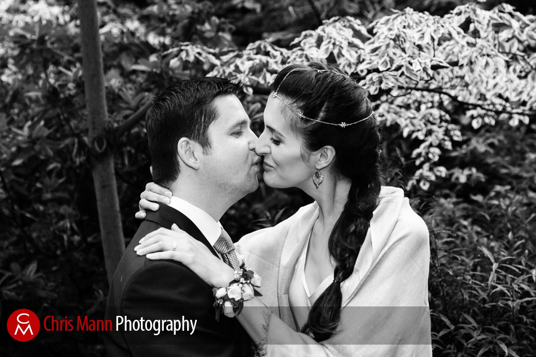 happy couple just married kiss in Mount Street Gardens