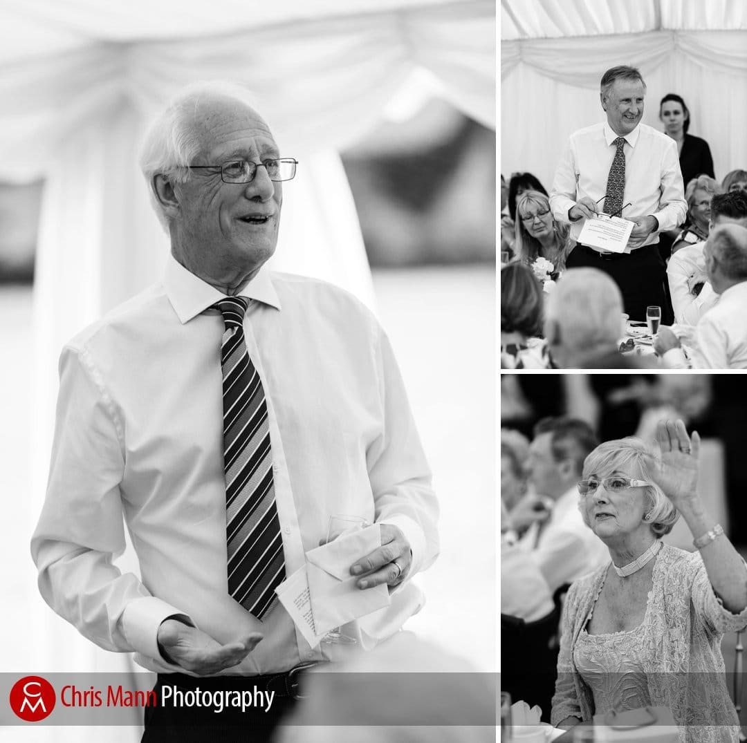groom and best man speak at wedding reception