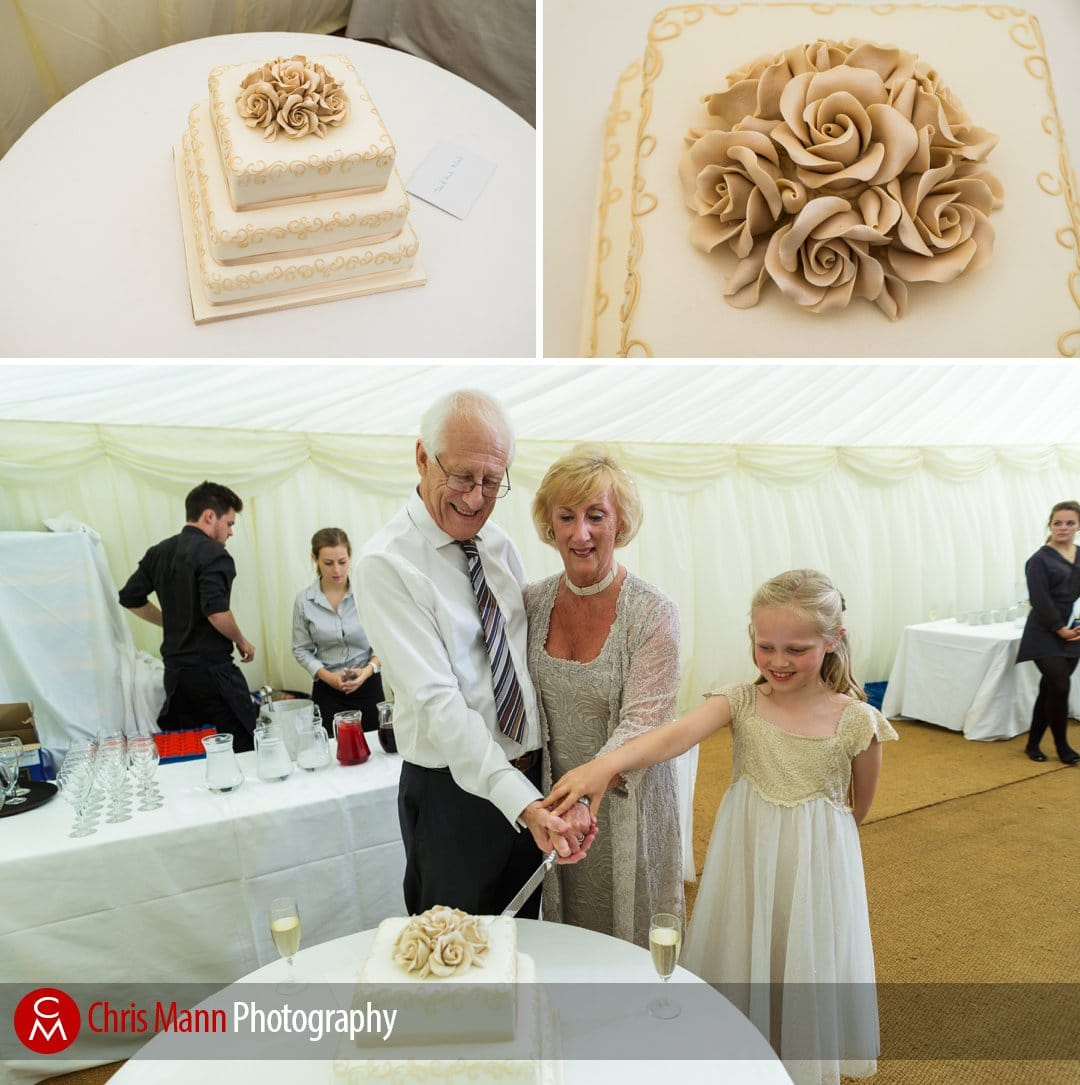bride and groom cut cake with flower girl