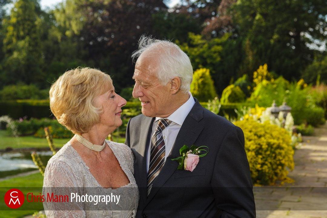 bride and groom in gardens Barnett Hill