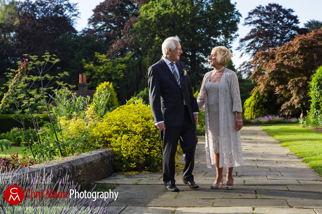 bride and groom walking in Barnett Hill gardens Surrey wedding