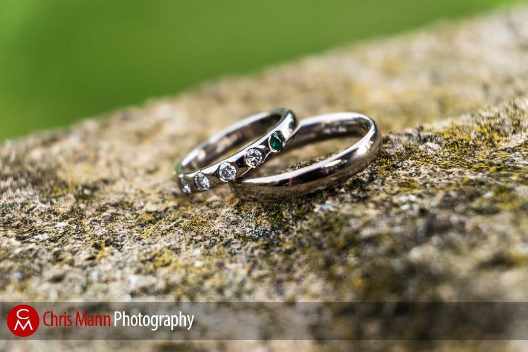 wedding rings close up on stone pillar