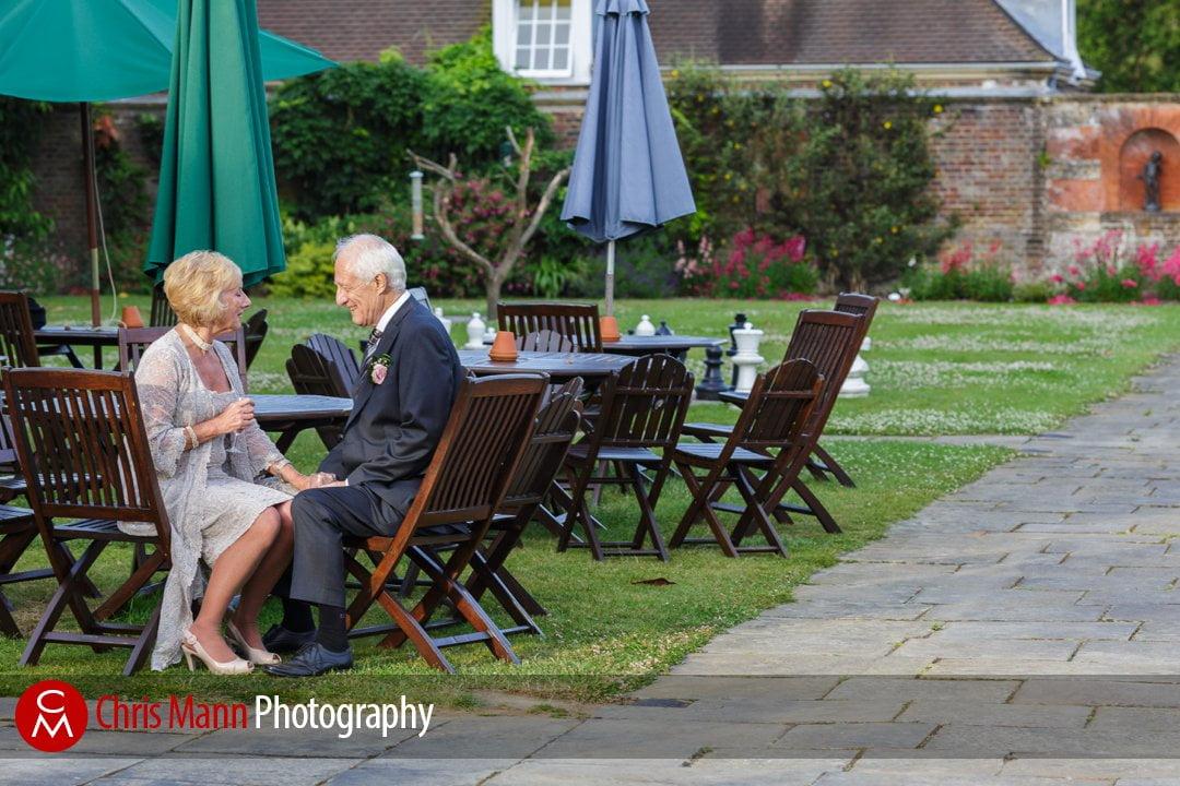 bride and groom in gardens Barnett Hill wedding venue surrey
