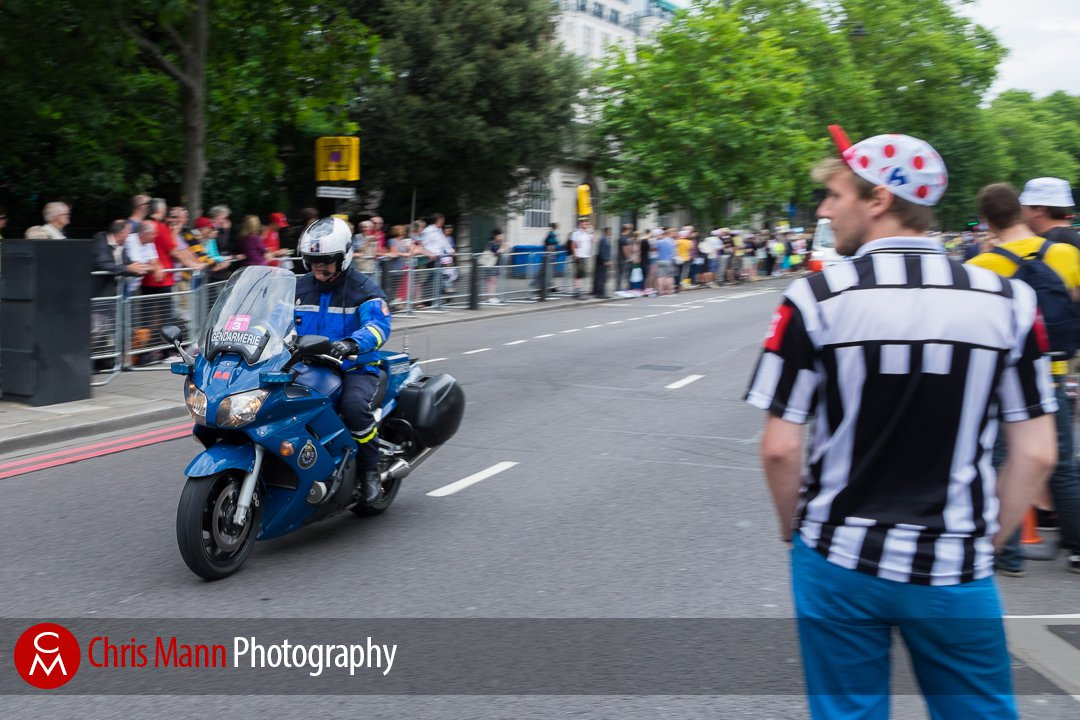 French gendarmerie motorcycle escorting Tour de France 2014 cycle race along the Embankment, London
