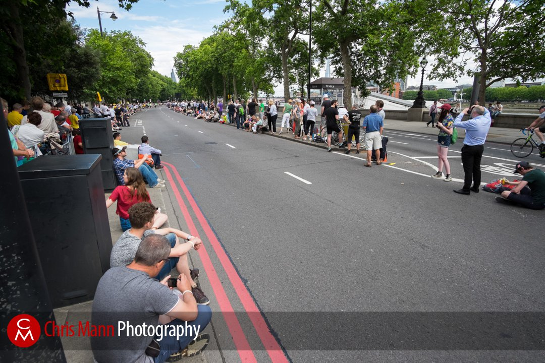 spectators wait for the cyclists to come along the Embankment