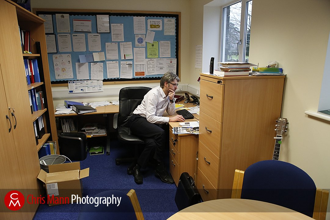 head teacher working in office