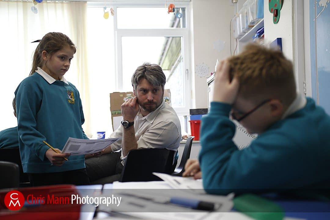 teacher helps pupil