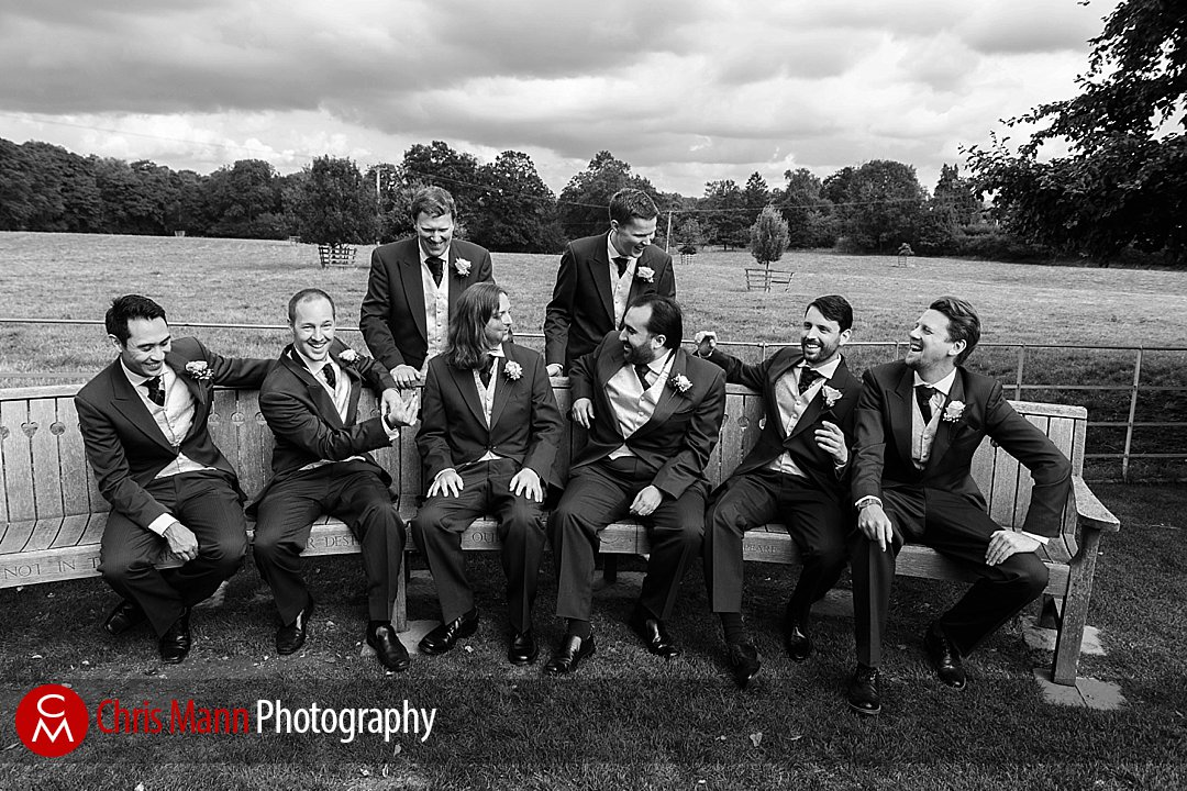 groom with groomsmen chatting Gate Street Barn