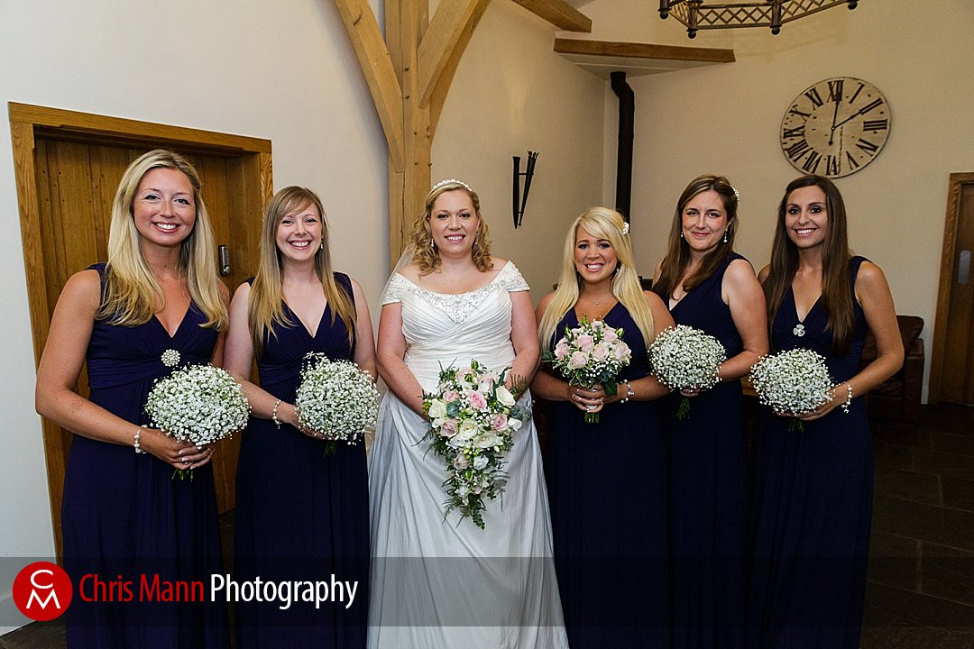 bride with bridesmaids vefore ceremony Gate Street Barn
