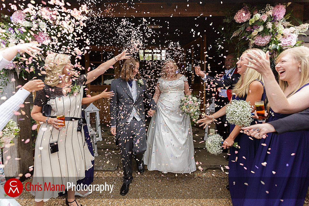bride and groom confetti toss Gate Street Barn
