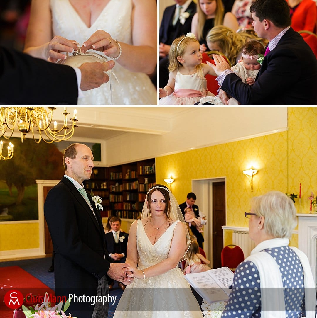 exchange of rings wedding at Manor House Hotel Guildford