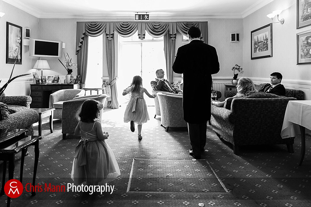 bridesmaids running at reception Manor House Hotel Guildford