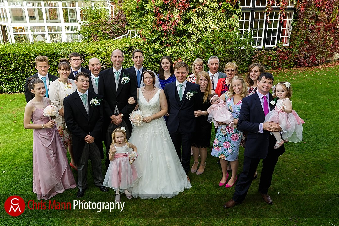 family group photo of all guests wedding Manor House Hotel Guildford