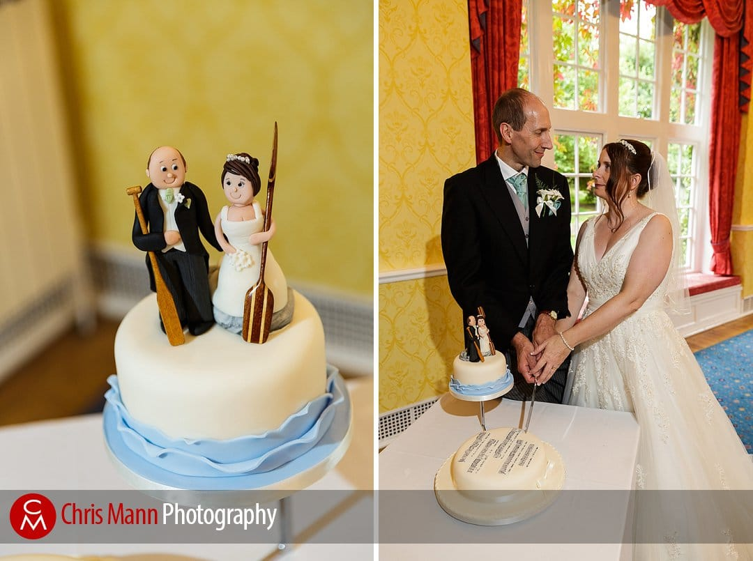 bride and groom cutting cake Manor House Hotel Guildford