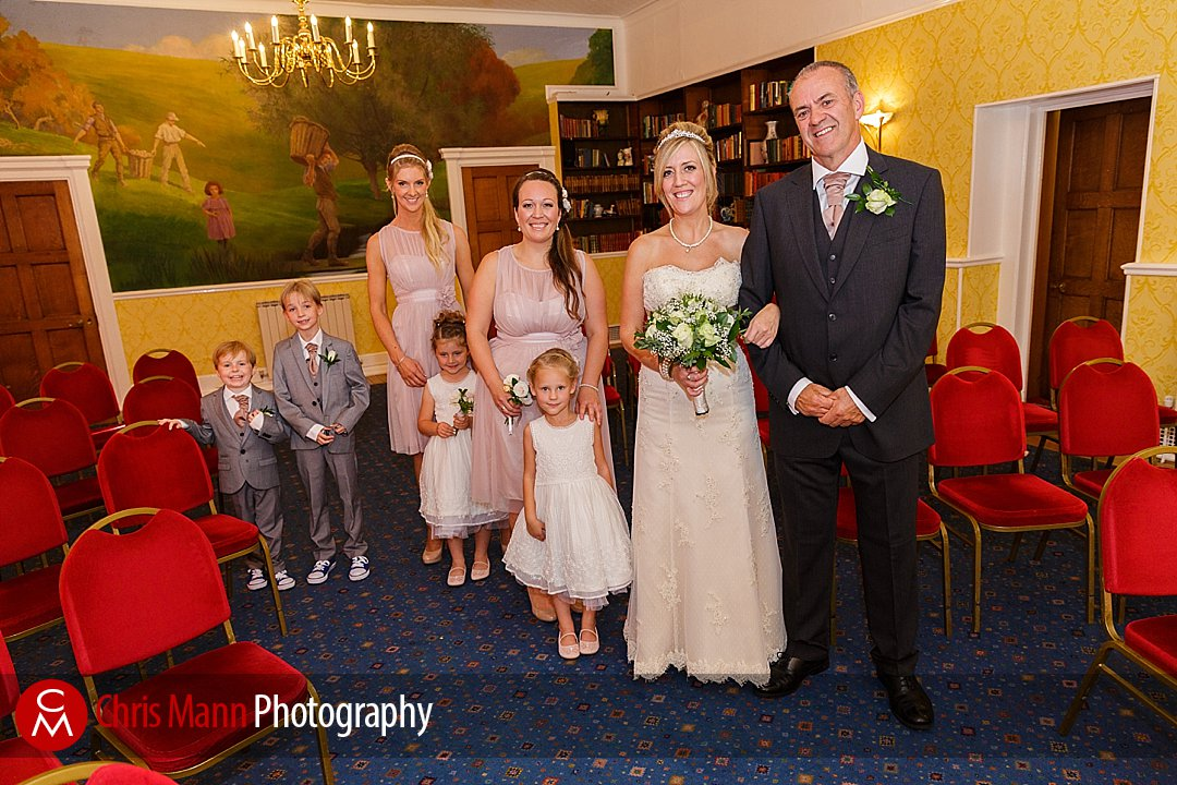 bride with father bridesmaids flower girls page boys Guildford wedding