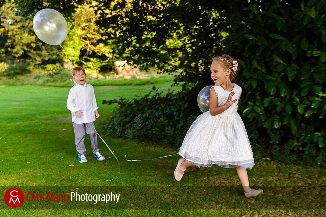 flower girl and pageboy run with balloons wedding Guildford Surrey