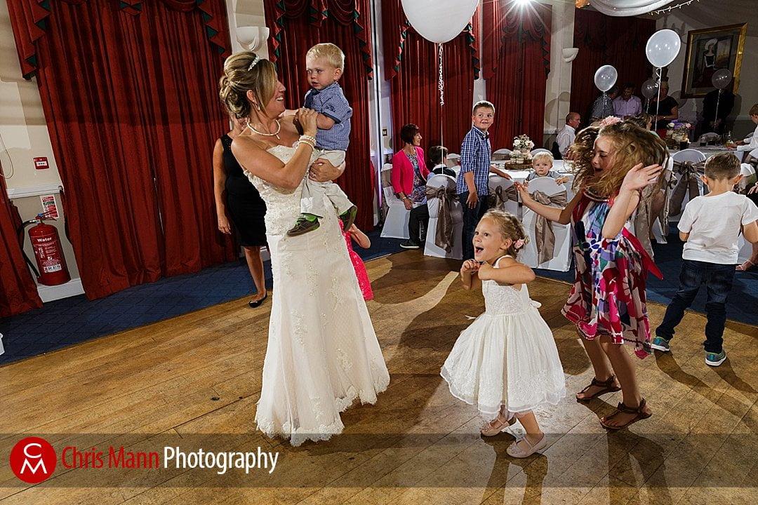 bride dances with children wedding Guildford Surrey