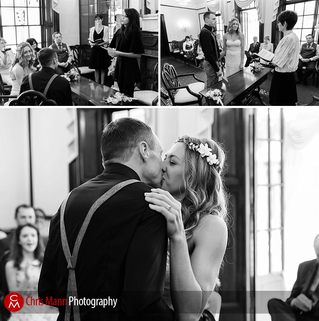 black and white wedding ceremony photos leatherhead registry office couple kissing