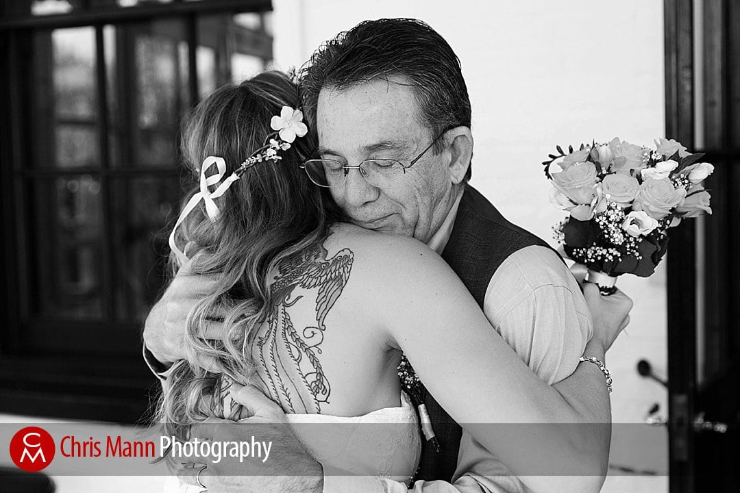 bride and father hug black and white photo