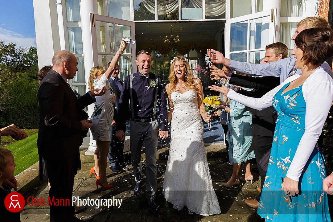 bride and groom exit confetti shower sunshine Leatherhead registry office