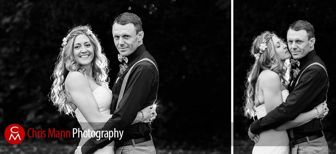 black and white photo bride and groom facing the camera