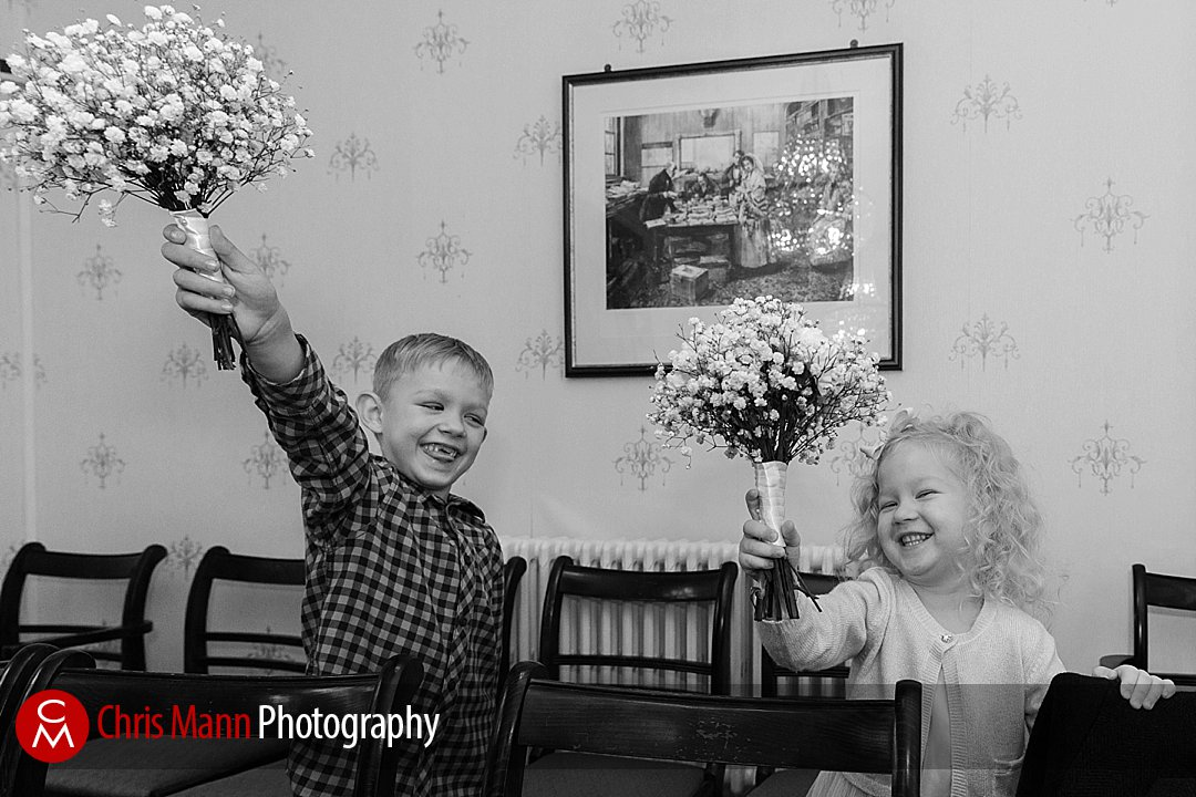 kids with wedding bouquets